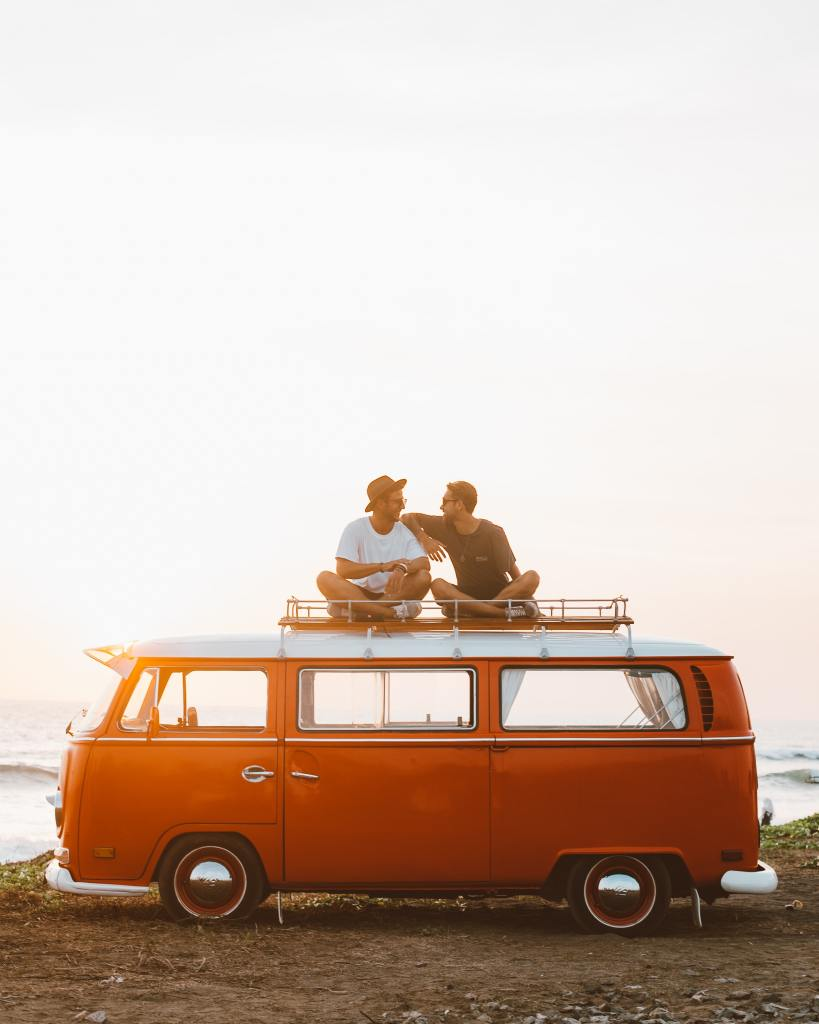 two hipsters and their van