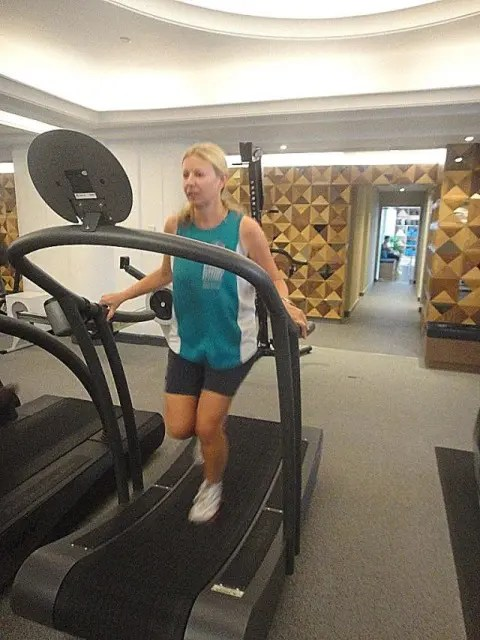 woman on a curved treadmill