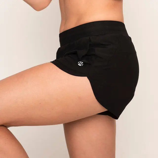 Woman wearing Modibodi running shorts