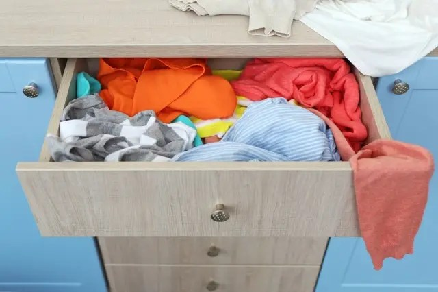 clothes spilling out of a drawer