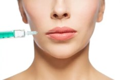 Woman having lip filler injection