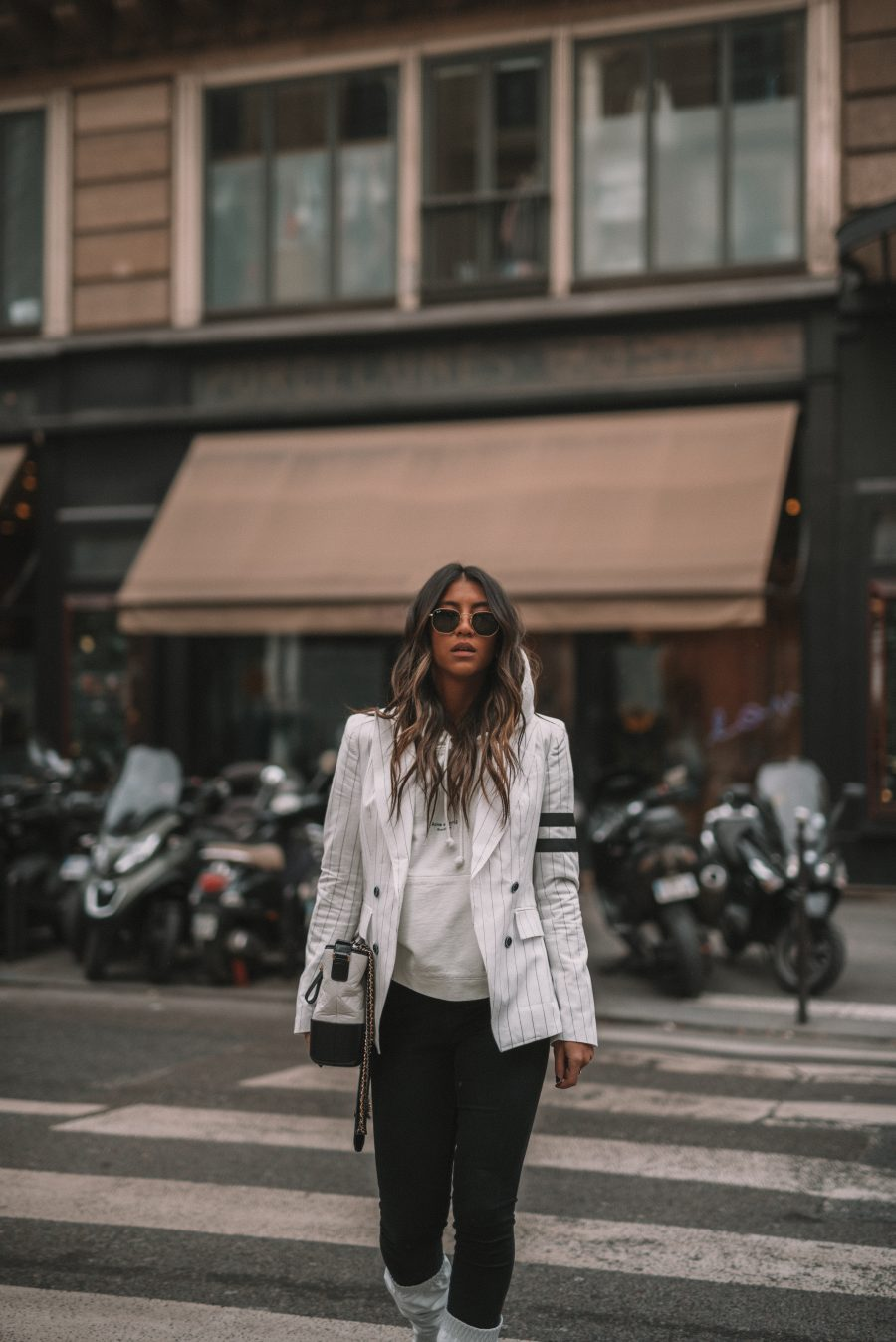 sosken blazer white stripe gabrielle chanel bag acne ice white hoodie sigerson morrison white boots igk texture hair spray texture waves mane addicts kayla seah not your standard paris fashion week streetstyle fall winter blogger cafe