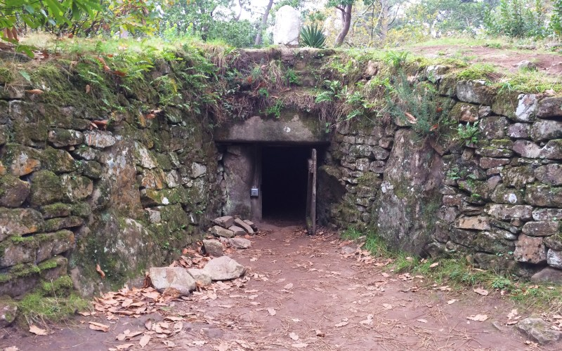 The entrance to a tumulu set into the hillside in Carnac, France.