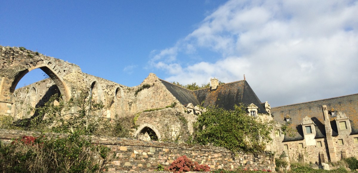 the abbaye de beauport in the sunshine with blue sky above