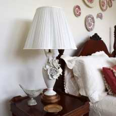 Use spray paint to upcycle an old lamp. A simple DIY project to update your home decor.