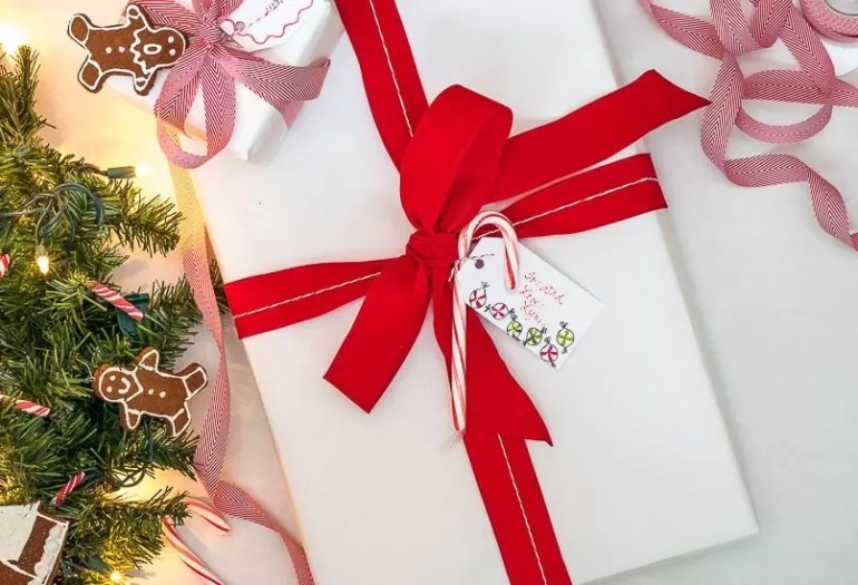 This sweet gift wrapping uses cinnamon-applesauce dough and candy canes to tell the recipients of your gifts that they are special to you.