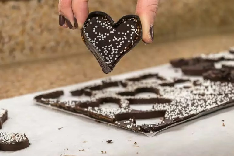 Recipe for Valentine's Day Chocolate Bark, with a variety of topping options. PLUS, a free printable for Valentine's Day gift tags.
