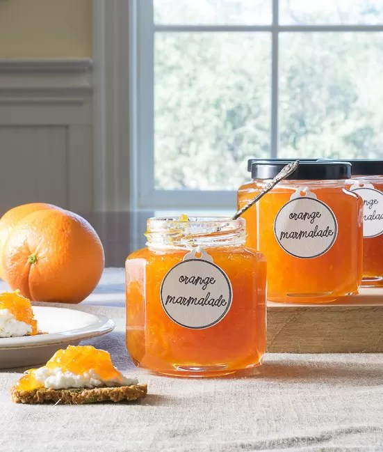 This Orange Marmalade tastes like sunshine in a jar! And need a quick appetizer? How about a dollop of marmalade on top of goat cheese? An easy recipe with canning suggestions.
