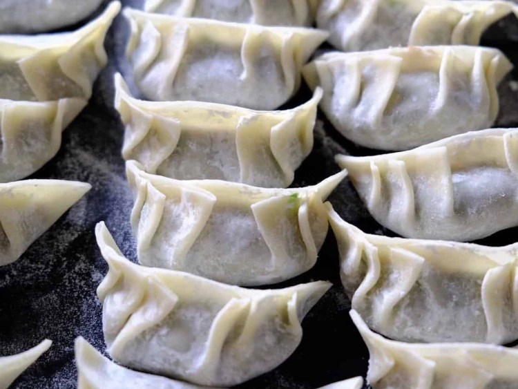 Authentic Chinese chive and pork dumplings - wrapping