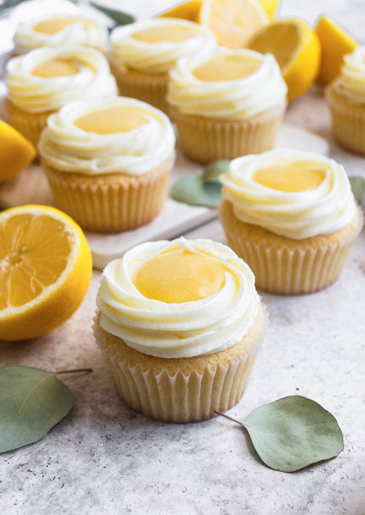 stylized lemon curd cupcakes from a angle