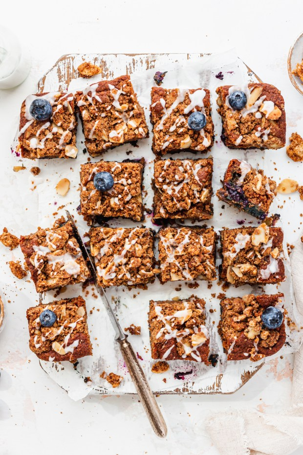 Blueberry Streusel Cake on a wooden board with a knife