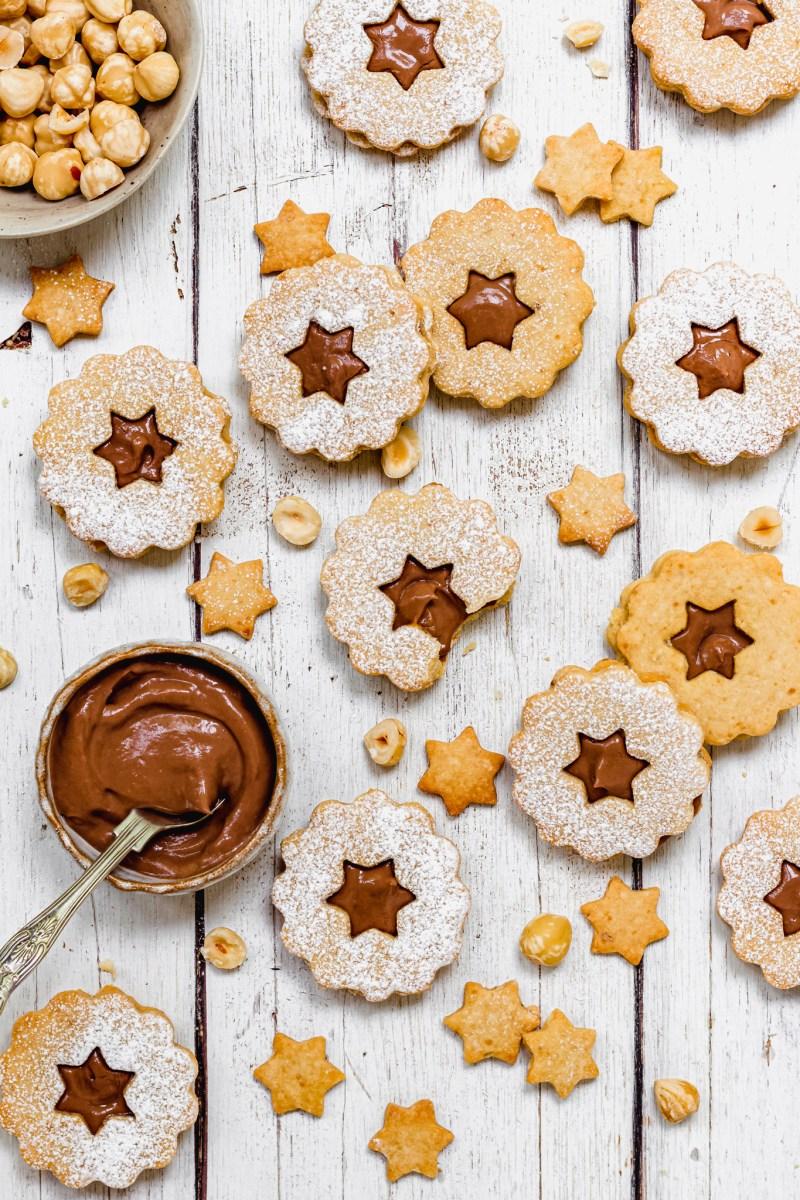 Chocolate Hazelnut Linzer Cookies on a white backdrop
