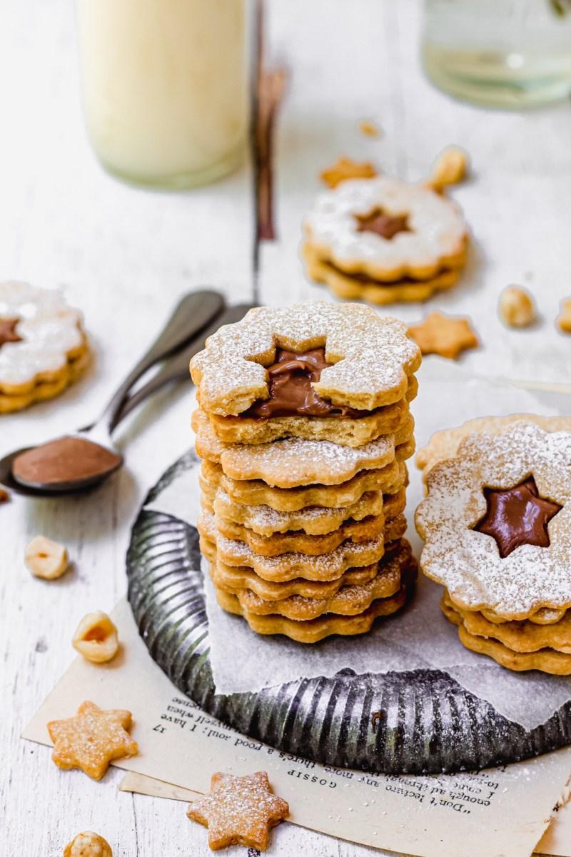A stack of Chocolate Hazelnut Linzer Cookies