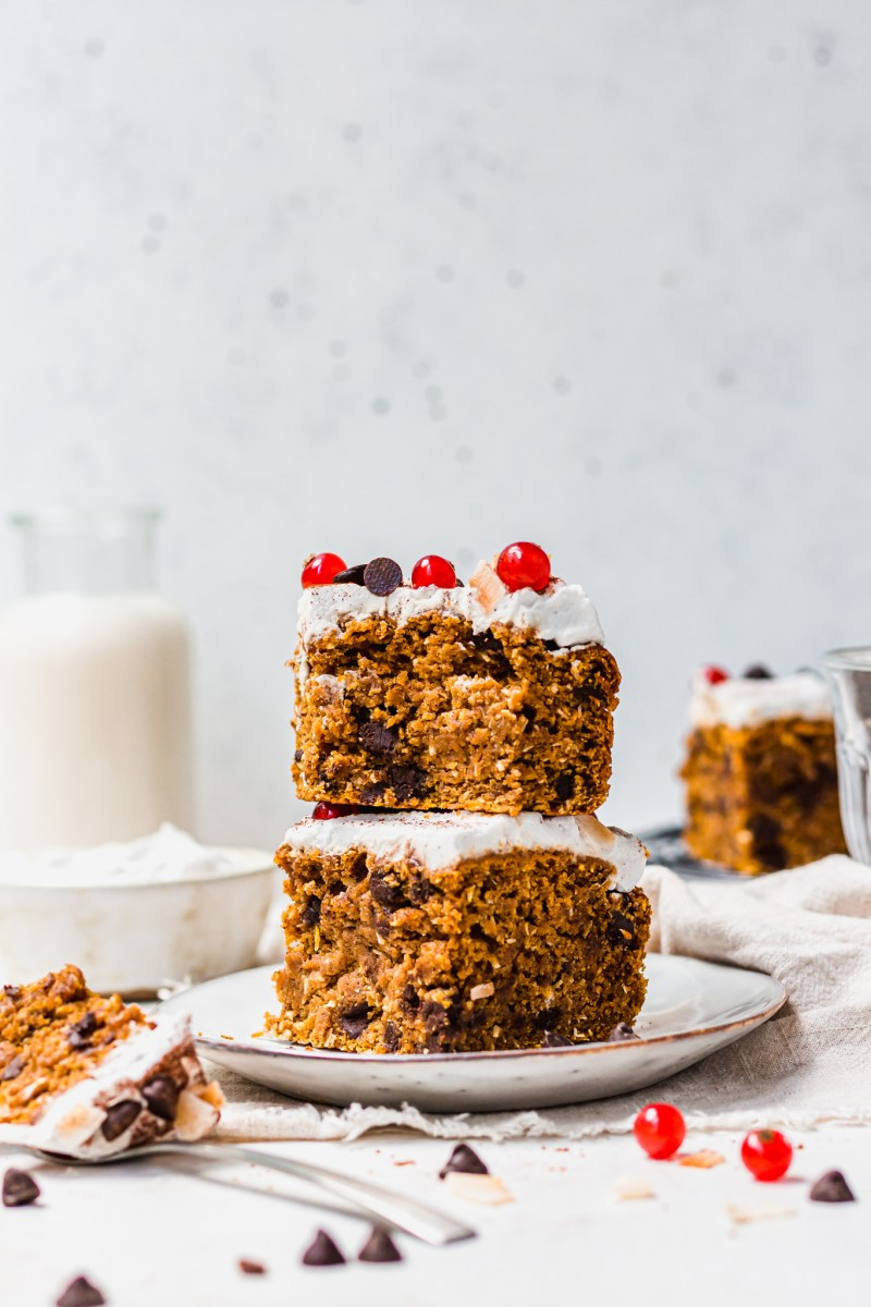 A stack of 2 pieces of Pumpkin Chocolate Chip and Coconut Cake