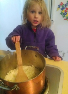 Stirring onions for chicken soup