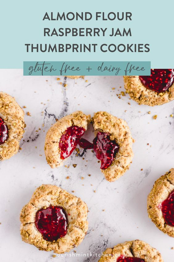Almond Flour Raspberry Thumbprint Cookies that are perfectly chewy, soft, and delicious! These festive cookies are gluten-free, dairy-free and refined sugar free.