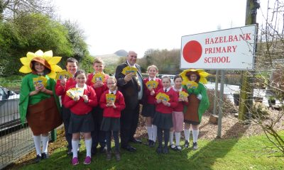 Mayor of Mid and East Antrim Paul Reid delivering sunflower seeds to pupils at Hazelbank PS, as well as other schools across the borough.