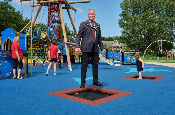 Chair of Mid Ulster District Council, Councillor Paul McLean has great fun trying out the inbuilt trampolines in the new play area at Ballyronan Marina.