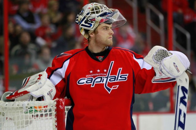 February 3, 2013; Washington, DC, USA;  Washington Capitals goalie Braden Holtby (70) stands on the ice against the Pittsburgh Penguins at Verizon Center. Mandatory Credit: Geoff Burke-USA TODAY Sports