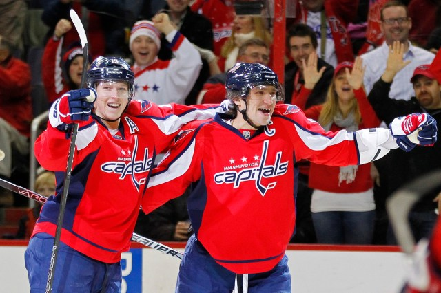 January 3, 2012; Washington, DC, USA; Washington Capitals left wing Alex Ovechkin (8) celebrates with Capitals center Nicklas Backstrom (19) after scoring a goal against the Calgary Flames in the first period at Verizon Center. Mandatory Credit: Geoff Burke-USA TODAY Sports