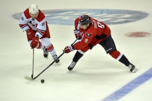 WASHINGTON, DC - SEPTEMBER 21: Carolina Hurricanes right wing Andrej Nestrasil (15) and Washington Capitals defenseman Dmitry Orlov (9) square off in the third period of the hockey preseason opener September 21, 2015 in Washington, DC. The Washington Capitals beat the Carolina Hurricanes 2-0. (Photo by Katherine Frey/The Washington Post)