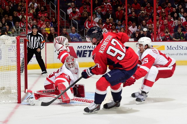 WASHINGTON, DC - OCTOBER 29: Evgeny Kuznetsov #92 of the Washington Capitals scores a goal in the second period during an NHL Game against the Detroit Red Wings at Verizon Center on October 29, 2014 in Washington, DC. (Photo by Patrick McDermott/NHLI via Getty Images)