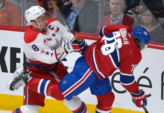 Washington Capitals' Alexander Ovechkin, left, checks Montreal Canadiens' P.K. Subban during first period NHL hockey action in Montreal, Saturday, April 20, 2013. THE CANADIAN PRESS/Graham Hughes.