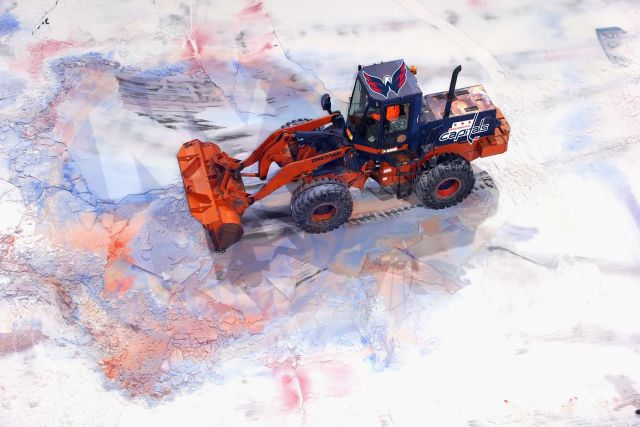 UNIONDALE, NY - MAY 05: A payloader removes the ice from the Nassau Coliseum on May 5, 2015 in Uniondale, New York. The New York Islanders have played their last game Nassau Coliseum and will begin to play at the Barclay's Center in the Brooklyn borough of New York City next season. (Photo by Bruce Bennett/Getty Images)