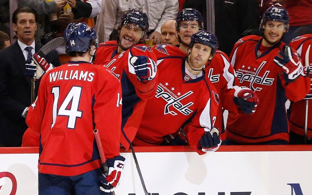 Dec 8, 2015; Washington, DC, USA; Washington Capitals right wing Justin Williams (14) celebrates with Capitals left wing Alex Ovechkin (8) after scoring a goal against the Detroit Red Wings in the first period at Verizon Center. Mandatory Credit: Geoff Burke-USA TODAY Sports