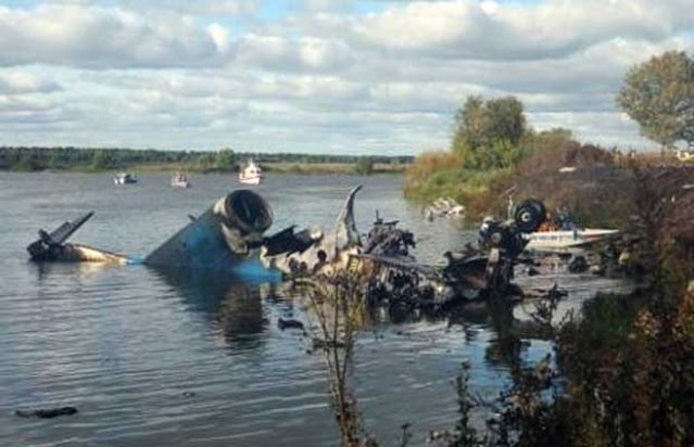 """RESTRICTED TO EDITORIAL USE - MANDATORY CREDIT """"AFP PHOTO / RUSSIA'S EMERGENCY MINISTRY """" - NO MARKETING NO ADVERTISING CAMPAIGNS - DISTRIBUTED AS A SERVICE TO CLIENTS A handout photo provided on September 7, 2011 by Russia's Emergency Ministry shows the wreckage of a Yak-42 passenger jet hull No 42434 that crashed on takeoff near Yaroslavl's city airport, some 300 kilometres (185 miles) northeast of Moscow, killing 44 people. Five foreign hockey players, including former Swedish Olympic champion Stefan Liv were among 44 people killed when the jet carrying Lokomotiv Yaroslavl ice hockey team crashed near the site of an annual forum attended by President Dmitry Medvedev. AFP PHOTO / RUSSIA'S EMERGENCY MINISTRY (Photo credit should read HO/AFP/Getty Images) [PNG Merlin Archive]"""