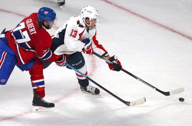Sep 24, 2015; Montreal, Quebec, CAN; Washington Capitals center Jakub Vrana (13) plays the puck against Montreal Canadiens defenseman Tom Gilbert (77) during the third period at Bell Centre. Mandatory Credit: Jean-Yves Ahern-USA TODAY Sports