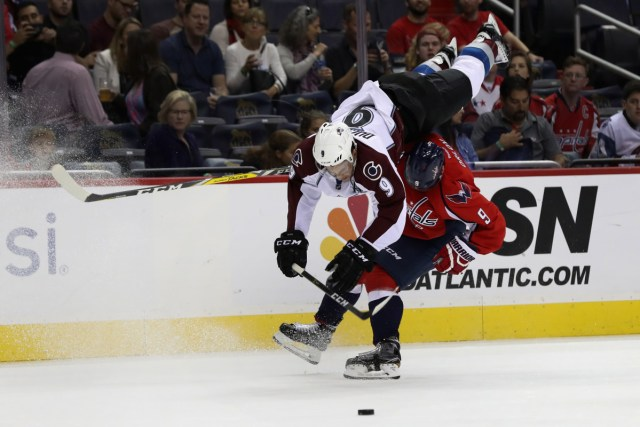 washington-capitals-dmitry-orlov-colorado-avalanche-hip-check-flip
