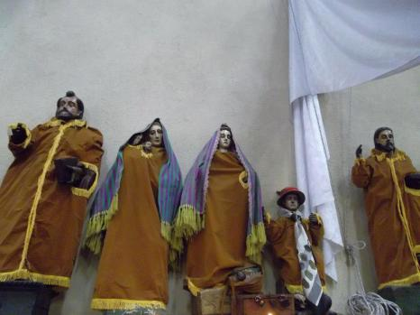 Inside the Church of Santiago Atitlán. The local women make clothes for these statues of the saints every year.