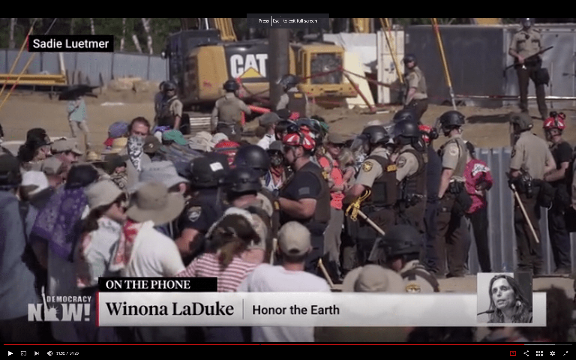 Screen capture from Democracy Now! broadcast on 8 June 2021 from Treaty People Gathering and action to #StopLine3 at Two Inlets site. Video at https://www.democracynow.org/2021/6/8/line_3_protests_treaty_people_gathering