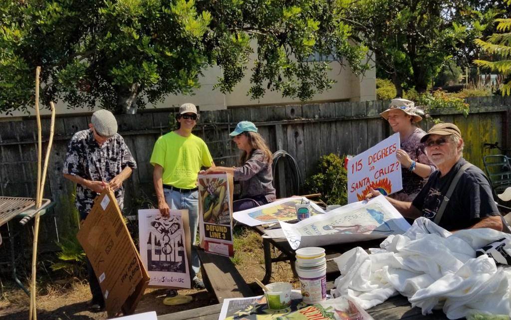 Santa Cruz activists preparing signs for Defund Line 3 actions