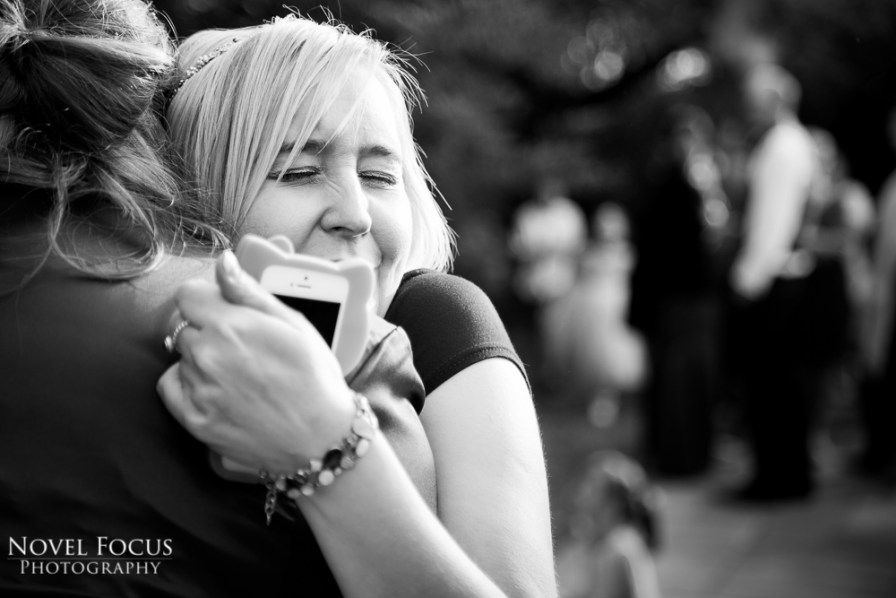 wedding photography guest hugging bride