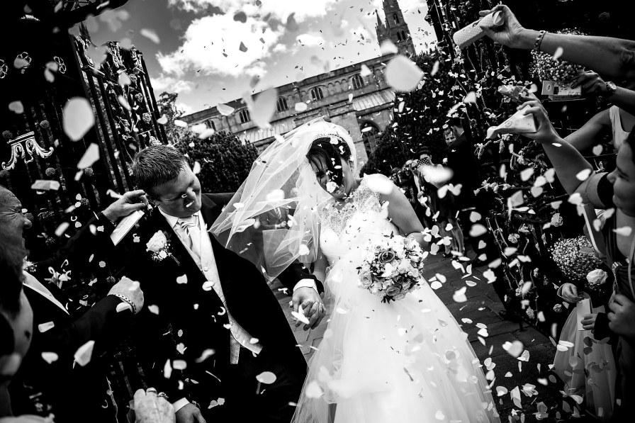 cheltenham wedding photographer bride groom confetti black and white
