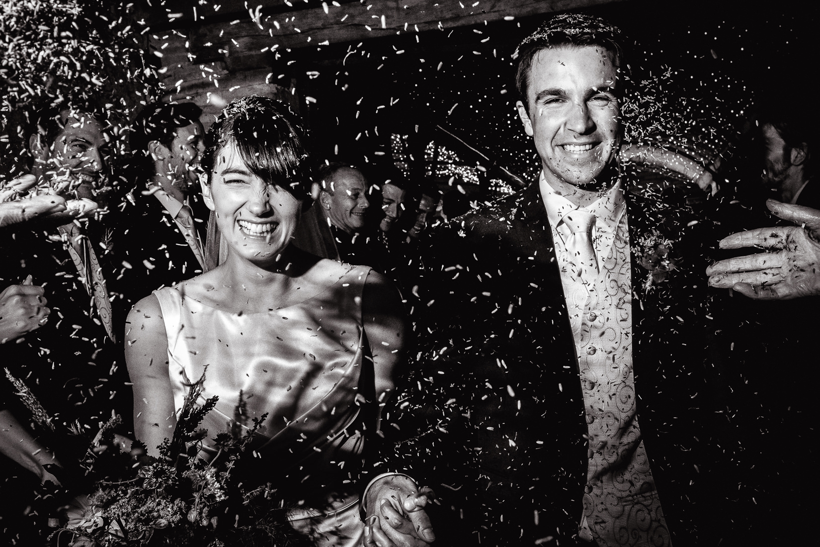 confetti as bride and groom leave wedding ceremony