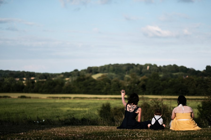 wedding reception guests looking over the countryside at bordesley park redditch