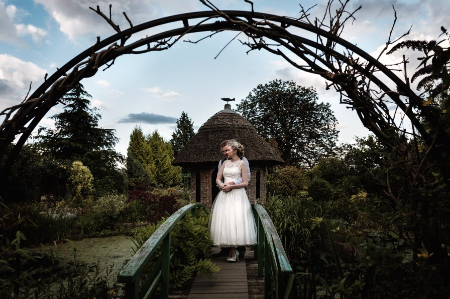 brockworth tithe barn bride and groom on bridge