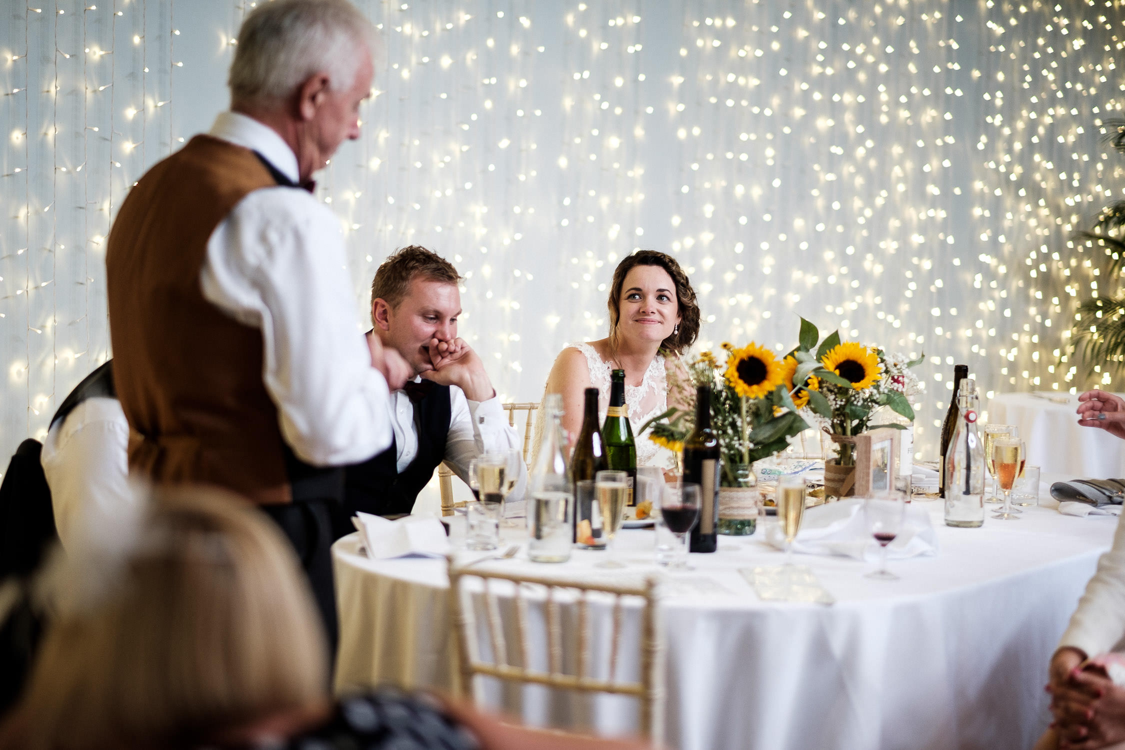 father of bride gives speech with bride looking at him