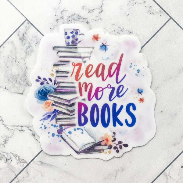 """watercolor design with stack of books and text """"read more books"""" in red, purple, and pink"""