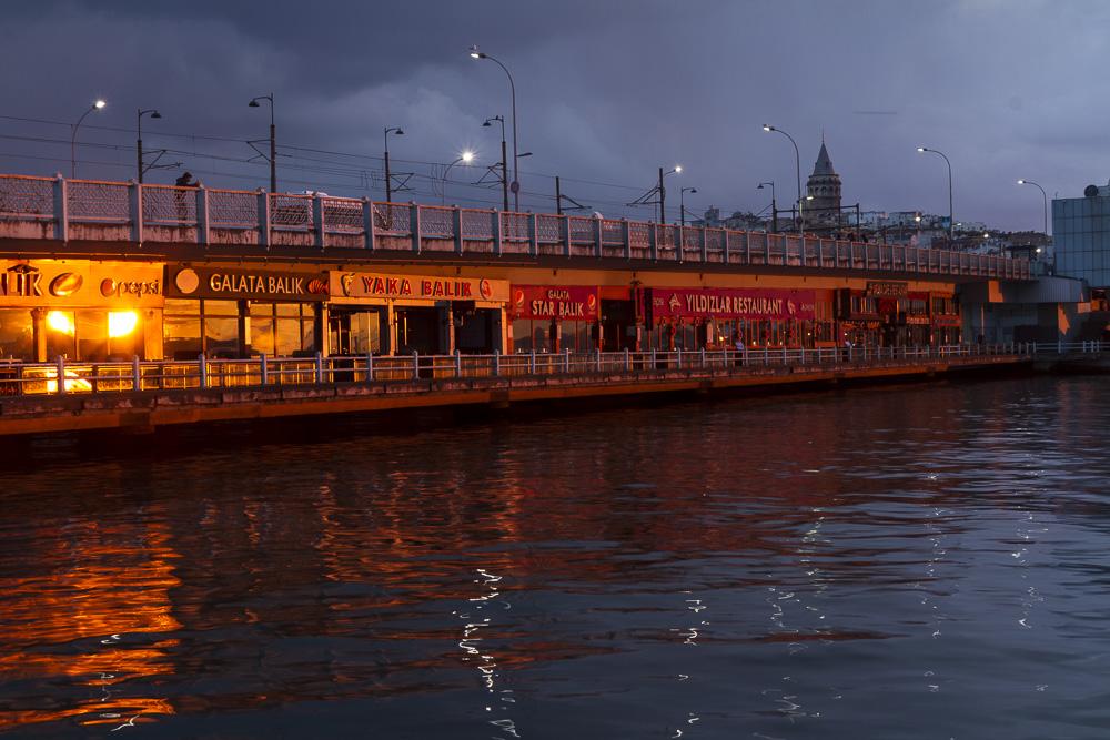 Sunrise on the European side of the Galata Bridge, Istanbul, Turkey.
