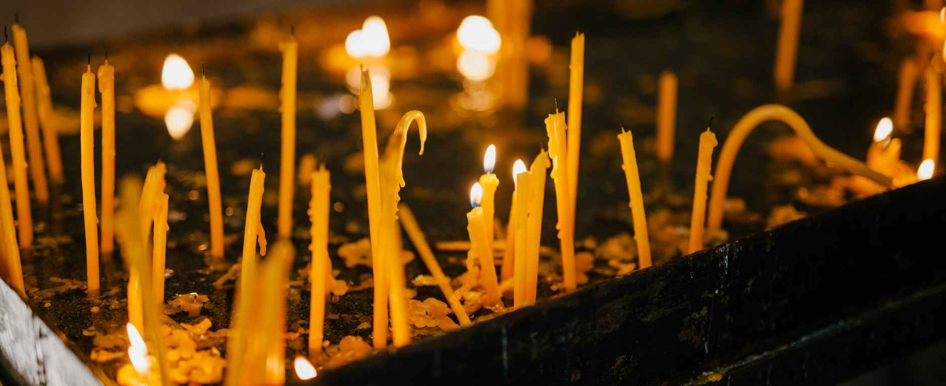 glowing candles in holy place of church