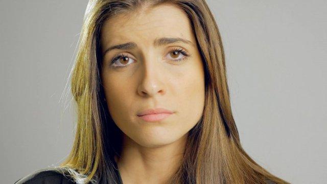 sad-beautiful-woman-looking-camera-feeling-lonely-and-heart-broken-4k-4eg-e4ucg-f0003