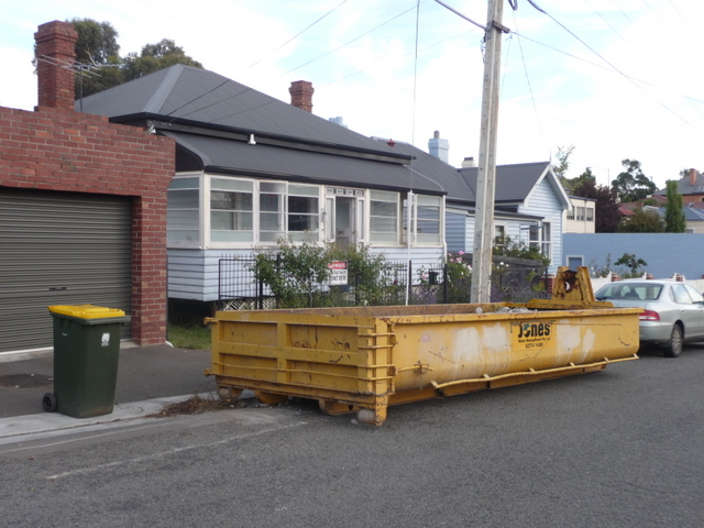 A huge skip was installed on the street outside