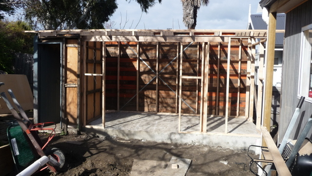 The 'new' shed takes shape in the still-muddy back yard