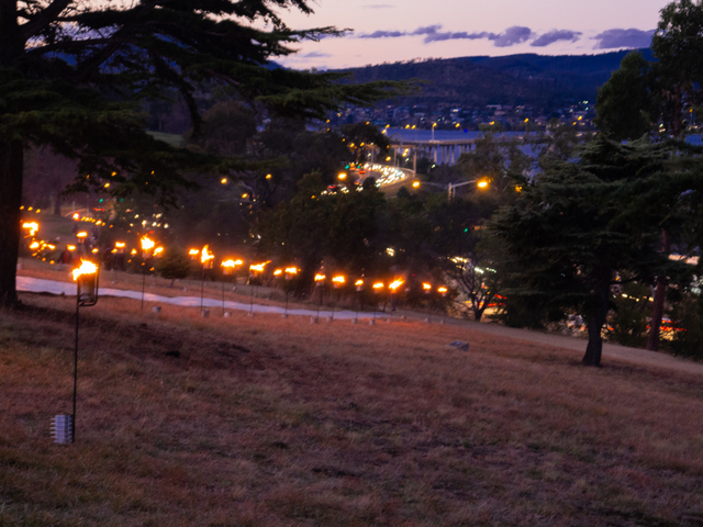 The Dark Path route across The Domain is lit by fire