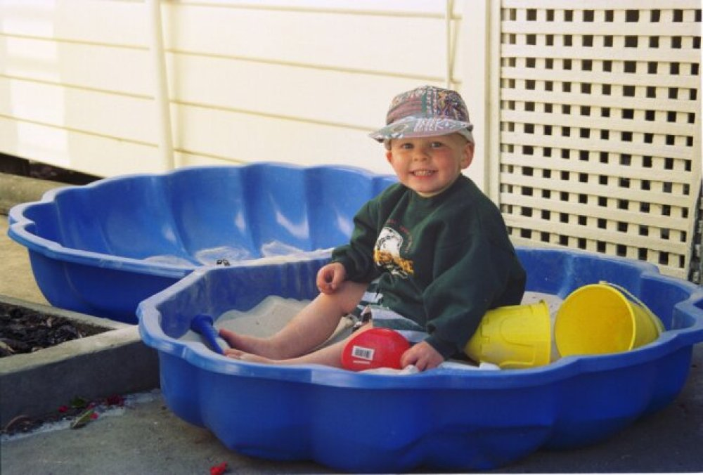 Alex in his new sand pit, Christmas 1994