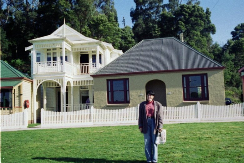 My friend Subi picutured outside of cottages repurposed as visitor accommodation in Strahan - circa 1993